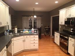 kitchens with black countertops red walls red mahogany
