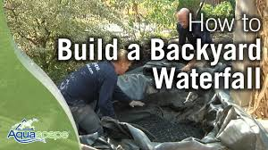 Waterfall In Backyard How To Build A Backyard Waterfall Youtube