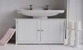 bathroom sink corner under sink storage under sink shelf