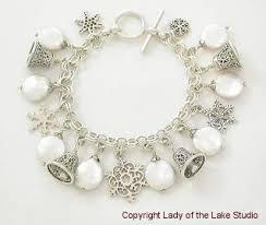 themed charm bracelet winter and christmas themed charm bracelets our snowbunny coin