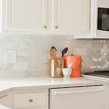 carrara marble subway tile kitchen backsplash white marble tiles with brass trim design ideas