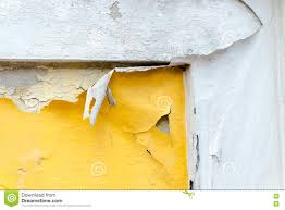 cracked yellow paint color concrete wall texture background stock
