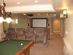 amazing finished basement with leather chairs and furniture chairs