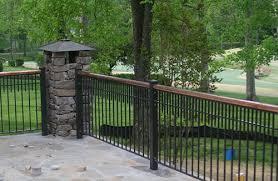 black wrought iron fence with redwood frame custom design work