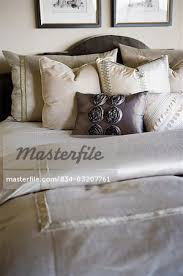 how to place throw pillows on a bed collection of throw pillows on bed stock photo masterfile