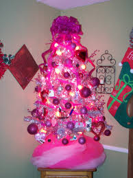 pink lucy 3 christmas trees in a row