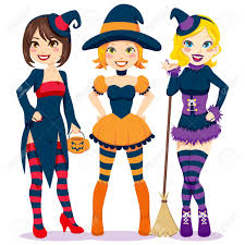 three beautiful young women in colorful and funny witch costumes