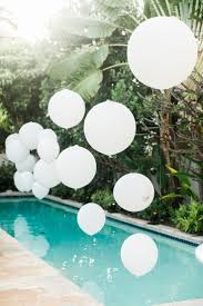 elegant and chic backyard pool party decorate using white