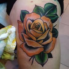 yellow rose tattoo on knee