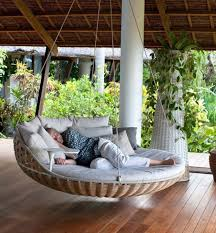 round hanging bed with outdoor area and wicker bed frame and trees