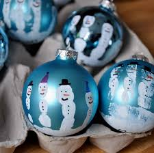 the 25 best snowman handprint ornament ideas on