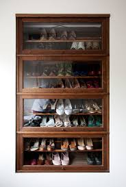 shoe storage ottoman in closet modern with shoe rack next to house