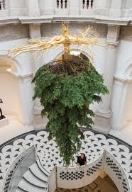 upside down christmas tree suspended from ceiling of tate britain