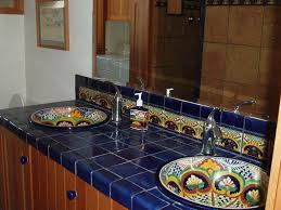 mediterranean master bathroom with mexican tile backsplash