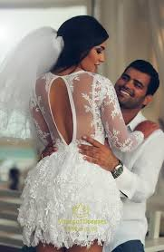 white sheer long sleeve embellished open back lace short wedding