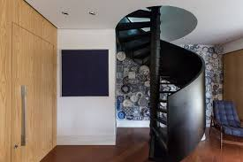 spiral staircase and fun accent wall steal the show at collector u0027s