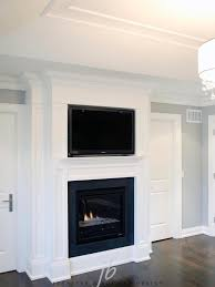 bedroom with flatscreen tv over gas fireplace