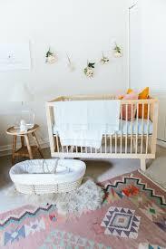 Modern Nursery Rug Adorable Nursery Features A Modern Wood Crib And A Woven Moses