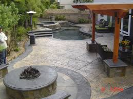 stone patio u0026 fire pit backyard remodel opr pools