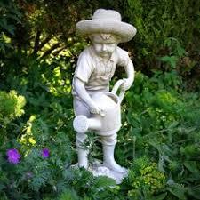 sitting garden statue search garden
