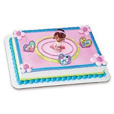 doc mcstuffins cupcake toppers decopac doc mcstuffins doc and lambie decoset cake