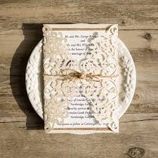 vintage wedding invitations cheap ivory vintage glittery laser cut wedding invitations with twine