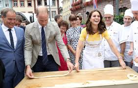 kate middleton and prince william burst out laughing as they try