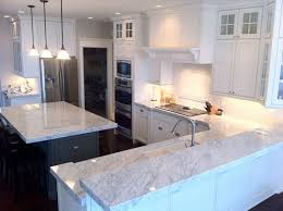 Backsplash With Marble Countertops - kitchen classic and timeless the white kitchen with black marble