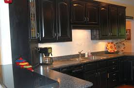 Distressed Black Kitchen Cabinets by Distressed Black Cabinets With Black Granite Countertops Home