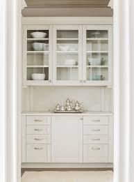 chic butler u0027s pantry is filled with glass front upper cabinets