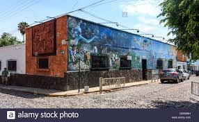 wall murals wrap a small one story building on a cobblestone stock photo wall murals wrap a small one story building on a cobblestone street in a quaint mexican town