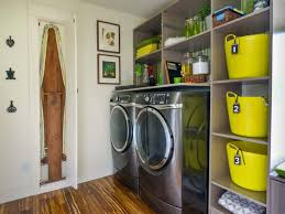 garage laundry room with yellow bins and ironing rack well