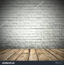 white painted brick room with wooden floor stock photo 147465845