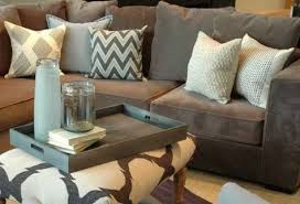 grey couch neutral pillows for downstairs basement when finished