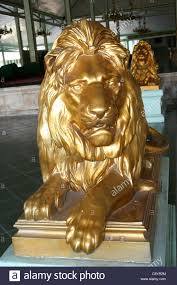 gold lion statues gold painted lion statues mangkunegaran palace java stock photo