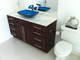 lovely small bathroom vanity design with unfinished wooden cabinet
