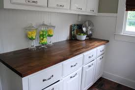 interior varnished hickory butcher block island top which