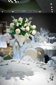 floral arrangement set in a martini glass wedding table centre