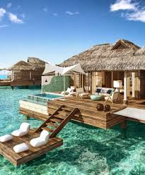 these overwater hotel suites are insane u0026 all inclusive quick