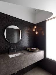 bathroom cabinets large round mirror on black small mosaic tiled