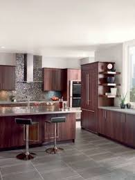Wood Kitchen Cabinets With Wood Floors by Gray Wood Floors Warm Cherry Cabinets White Counters