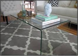 all glass coffee table put a waterfall coffee table over another coffee table makes a