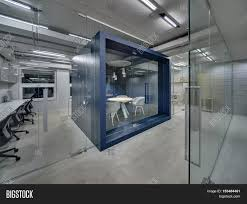 dark blue meeting room with a furniture and a glass door in the