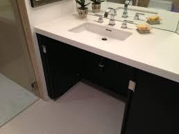 handicap bathroom vanity having interesting photographs as