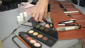 make up artist supplies a conference room table of various business supplies