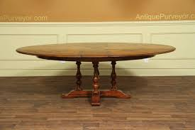 Round Dining Table Extends To Oval 78 94 Oval To Oval Solid Walnut Jupe Dining Table