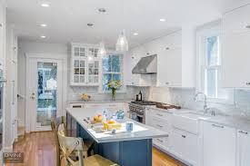 white kitchen cabinets with blue subway tile boston newton tansitional kitchen blue gray island