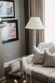 living room with framed wall pictures and floor lamp buying