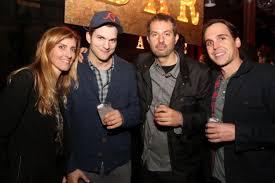 mila kunis flashes ring parties separately from ashton kutcher