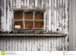 old window of wooden house painted peeling white paint stock photo